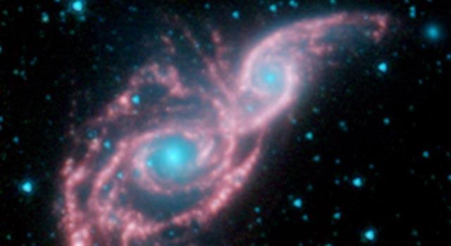 Черные дыры перед слиянием галактик скрываются в«шубу» изпыли— Ученые
